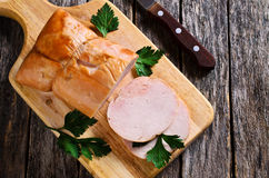 Piece of cooked ham. On a wooden surface. Selective focus Royalty Free Stock Photo
