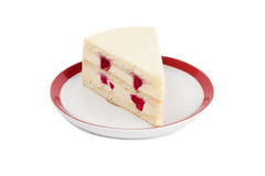 Piece of cream cheese cake with rasbberry Royalty Free Stock Image