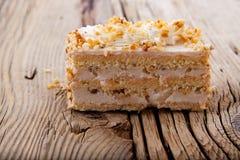 Piece of creamy hazelnut cake on Royalty Free Stock Images