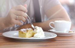 Piece Of Creamy Sweet Cake cut a man`s hand with a fork. Stock Photography