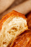 Piece of croissant pastry, extremely closeup Stock Photo