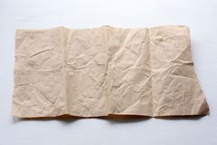 A piece of crumpled paper on a light background stock photography