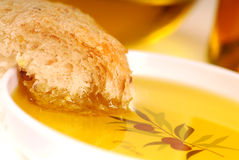 Piece of crusty bread in a bowl of olive oil Stock Photo