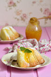 Piece of curd casserole (pudding) with honey dressing. Royalty Free Stock Image