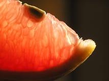Piece of cut orange stock photos