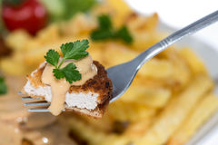 Piece of Cutlet on a fork Stock Photos