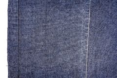 Piece of dark blue jeans fabric Stock Images