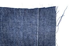 Piece of dark blue jeans fabric Stock Image