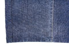 Piece of dark blue jeans fabric Royalty Free Stock Photo