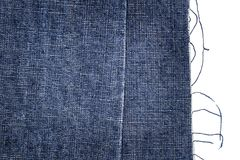 Piece of dark blue jeans fabric Royalty Free Stock Images