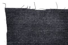 Piece of dark jeans fabric Royalty Free Stock Photography