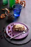 Piece of delicious cake, cranberry dessert, chocolate roll, served with lemonade. Stock Image