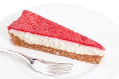 A piece of delicious cake with strawberries and cream. Royalty Free Stock Image