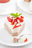 Piece of delicious cake with whipped cream and strawberries Royalty Free Stock Images