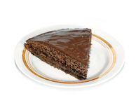 Piece of delicious chocolate cake on a plate isolated Stock Images
