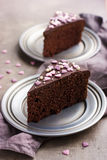 Piece of delicious chocolate cake for romantic dinner Stock Images