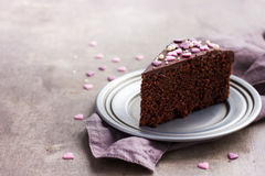 Piece of delicious chocolate cake for romantic dinner Royalty Free Stock Images