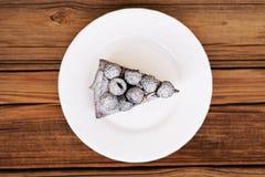 Piece of delicious chocolate pie with fresh blackberries decorat Stock Photo