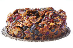 Piece of Delicious Fruit and Nut Cake. By a Fork on a Plate Royalty Free Stock Photography