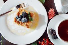 A piece of delicious Napoleon, decorated with blackberries and blueberries stock image