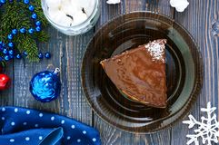 A piece of delicious two-color cake with chocolate and coconut chips stock image