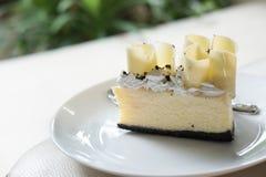 delicious white chocolate cake. tasty dessert on white plate. ho Stock Photo