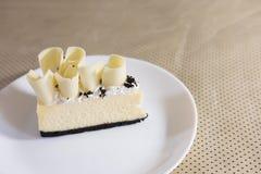Delicious white chocolate cake. tasty dessert on white plate. ho Royalty Free Stock Photos