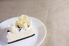 Delicious white chocolate cake. tasty dessert on white plate. ho Royalty Free Stock Photo
