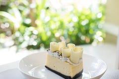 Delicious white chocolate cake. tasty dessert on white plate. ho Stock Photos