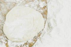 Piece of dough on white flour. As background royalty free stock image