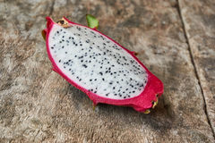 A piece of dragon fruit on the wooden board  Image ID:476757136 Royalty Free Stock Photo