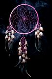 Piece of dream. Pink dream catcher with puff of smoke on black background Royalty Free Stock Photos