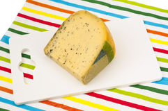 Piece of Dutch cheese with herbs Royalty Free Stock Photos