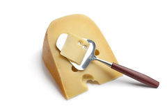 Piece of Dutch farmers cheese with a cheese-slice Royalty Free Stock Image