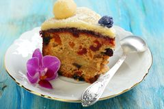 Piece Easter cake with candied fruit and marzipan. Royalty Free Stock Photos