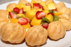 Piece of Eclair Cream Custard  and fresh fruit Stock Photo