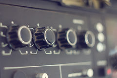 Piece of electrical audio equipment with knobs Royalty Free Stock Images