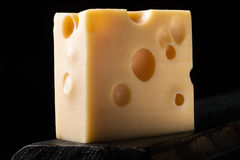 Piece of emmental cheese Royalty Free Stock Image