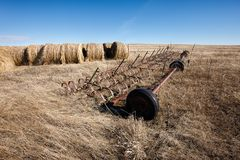 Machinery and large hay bales. Royalty Free Stock Photography