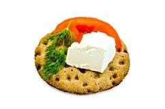 Feta piece with tomato and dill on crispbread Stock Photo