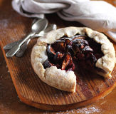 Piece of fig and raspberry galette pie with icing sugar Stock Photography