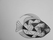 Wall Fish Art In Grey. A piece of fish art, made of metal pieces and wire, done in greys stock image