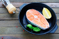 Piece of fish fillets and lemon in a pan Stock Photo