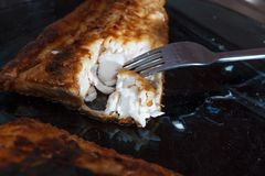 A piece of fish fillett fried in batter Royalty Free Stock Images
