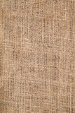 Piece of frayed burlap background Royalty Free Stock Images