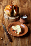 Piece of French Brioche Bun. With Chocolate Filling on brown plate, on wooden background stock photos