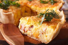 Piece of French quiche Lorraine macro. horizontal Royalty Free Stock Image