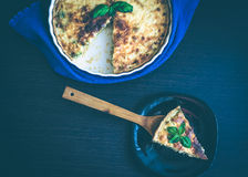 Piece of French quiche Lorraine pie Stock Images