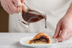 A piece of fresh baked delicious sponge-cake with chocolate sauc Stock Photography