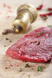 Piece of fresh beef and spises Stock Photos
